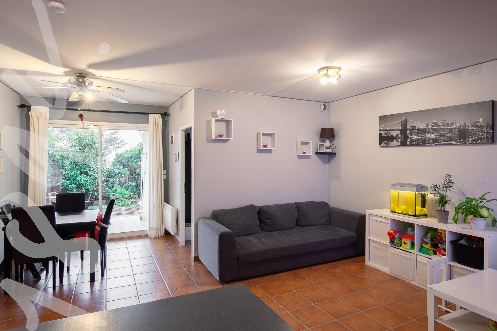Appartement T3 d'environ 60m² avec terrasse de 25m² et deux places de parking