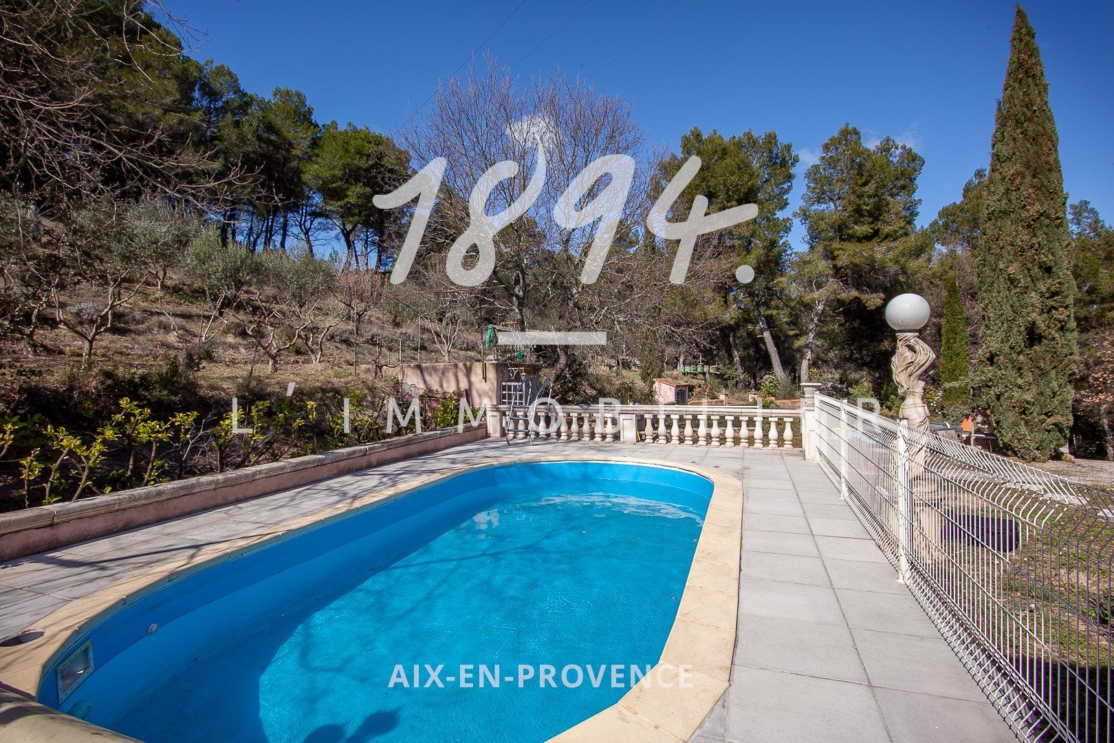 Maison de Type 4 d'environ 101m2 sur 8600m2 de terrain avec piscine à Rognes