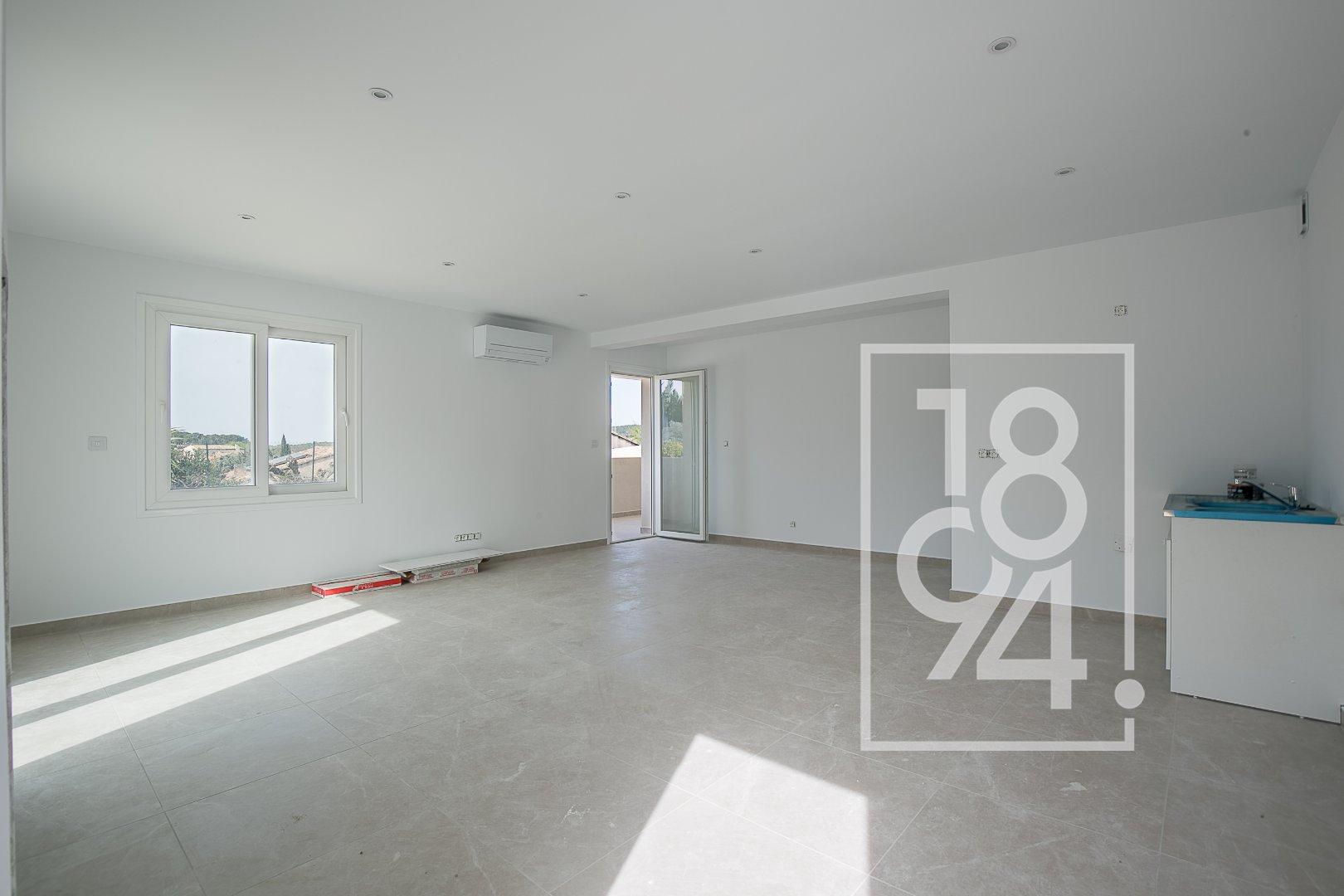 Appartement neuf traversant T3 d'environ 82m2 avec balcon et places de stationnement à Velaux